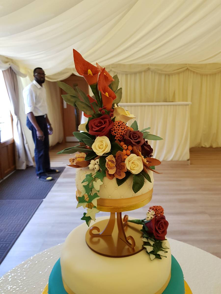 Image of Floral decorations for a very special wedding cake